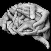 Likeness of a human brain created by hands
